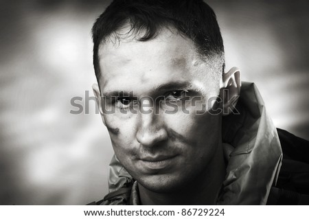 Portrait of handsome tired sad male soldier, black and white