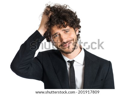 Portrait Of Handsome Uncertain Man Isolated On White Background - stock photo
