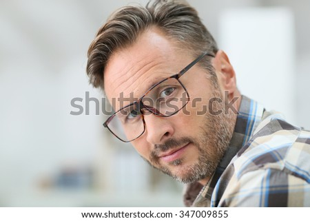 Portrait of handsome 40-year-old man with eyeglasses - stock photo