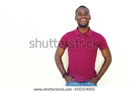 Portrait of handsome young african male model standing against white background