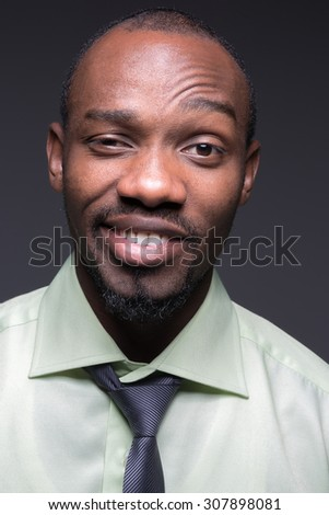 portrait of handsome young black african smiling man - stock photo