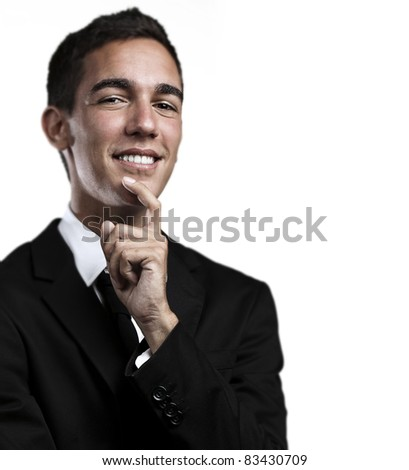 portrait of handsome young business man thinking and looking up against a blue background - stock photo