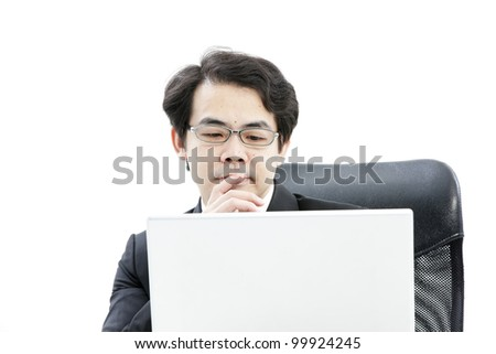 Portrait of handsome young business man using new laptop - stock photo