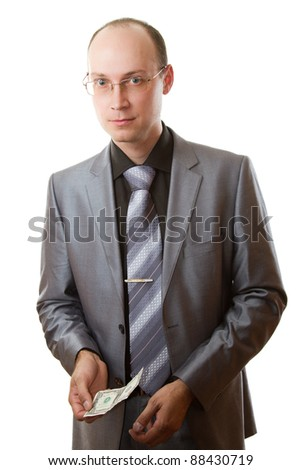 Portrait of handsome young business man wearing tie and glasses keep dollar in hands on white background - stock photo