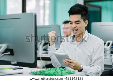 Portrait of handsome young businessman happy rejoicing for his success at office. Asia people businessman. - stock photo