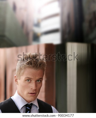 Portrait of handsome young businessman in a back alley