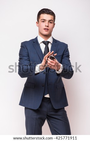 Portrait of Handsome young businessman  in suit clean hands standing against white background - stock photo