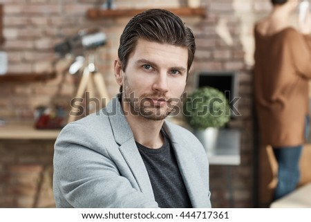 Portrait of handsome young businessman, looking at camera. - stock photo