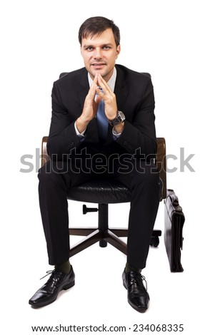 Portrait of handsome young businessman sitting on chair isolated on white - stock photo