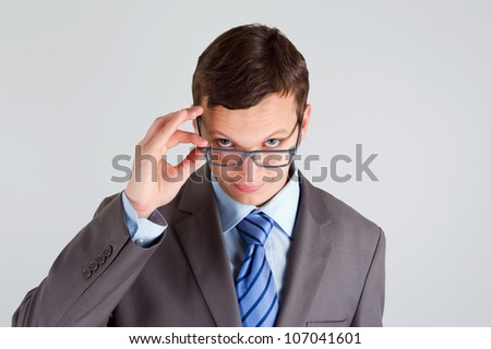 Portrait of handsome young businessman wearing glasses - stock photo