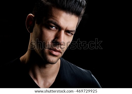 Portrait of handsome young caucasian man, looking at camera.