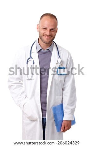 Portrait of handsome young doctor in lab coat, smiling, looking at camera. - stock photo