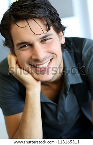 Portrait of handsome young guy with black shirt - stock photo