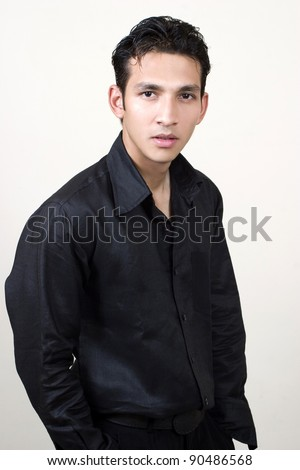 portrait of handsome young indian fashion model - stock photo