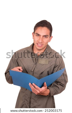 portrait of handsome young male pilot wearing green uniform holding file folder isolated on white - stock photo