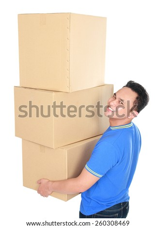 portrait of handsome young man carrying stack of cardboxes - stock photo