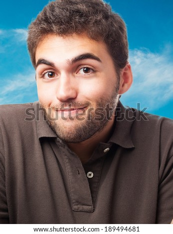 portrait of handsome young man doing a doubt gesture - stock photo