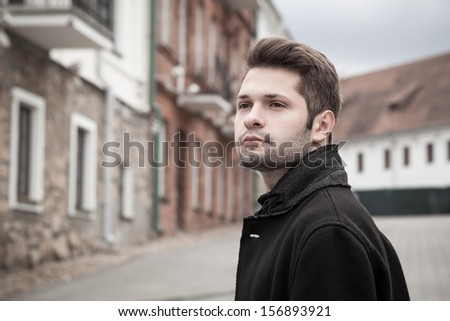 portrait of handsome young man in the old town