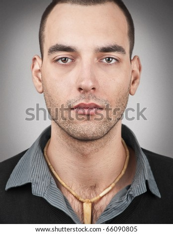 Portrait of handsome young man looking at camera - stock photo