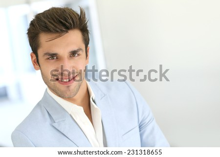 Portrait of handsome young man on white background - stock photo