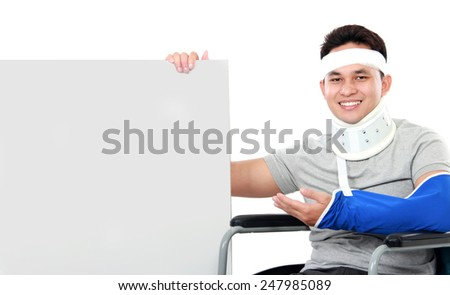 portrait of handsome young man present the grey board - stock photo