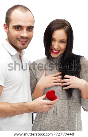 Portrait of handsome young man proposing marriage to a beautiful woman isolated on white background