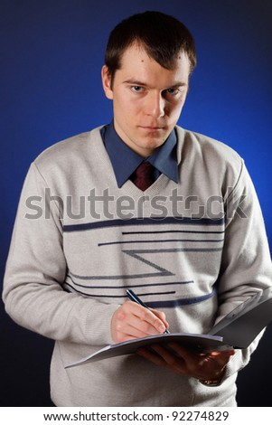 portrait of handsome young man reading a contract - stock photo
