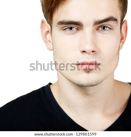 Portrait of handsome young man, sexy guy looking at camera over white background - stock photo