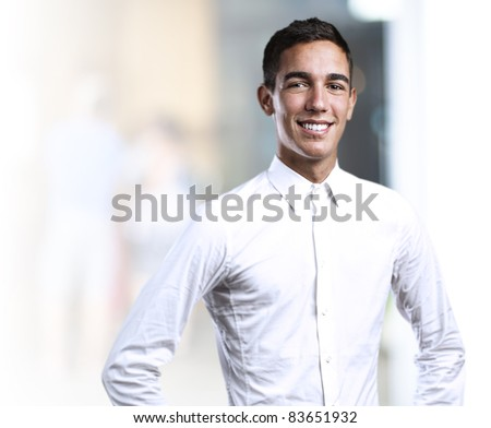 portrait of handsome young man smiling in a house - stock photo