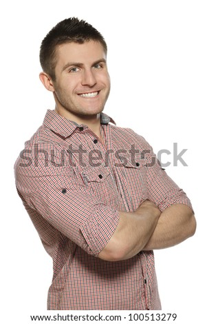 Portrait of handsome young man smiling over white background with hands folded - stock photo