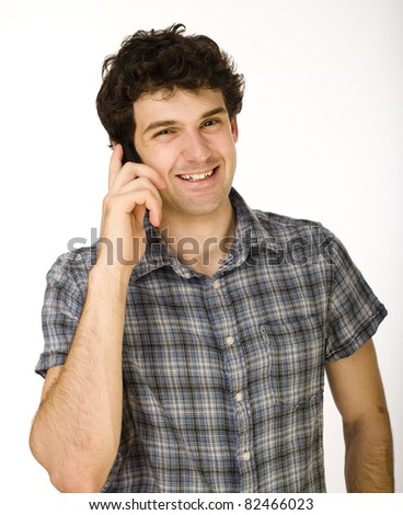 Portrait of handsome young man using cellphone isolated