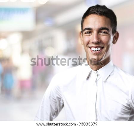 portrait of handsome young man with a city as a background - stock photo