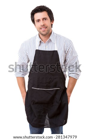 Portrait of handsome young man with apron against white background - stock photo