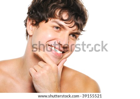 Portrait of handsome young man with clean-shaven face and happy smile - stock photo