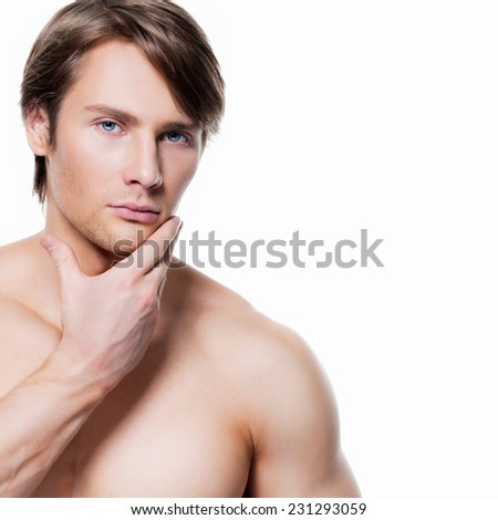 Portrait of handsome young man with hand near the face looking at camera on white background. - stock photo