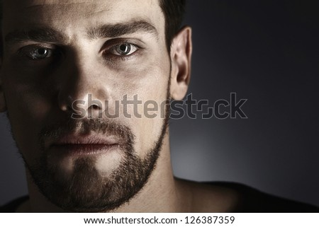 portrait of handsome young man with stubble