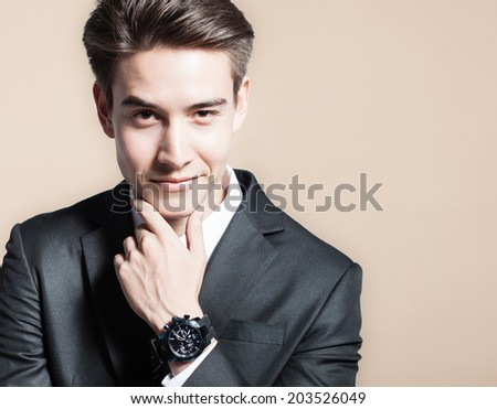 Portrait of handsome young smiling business man. - stock photo