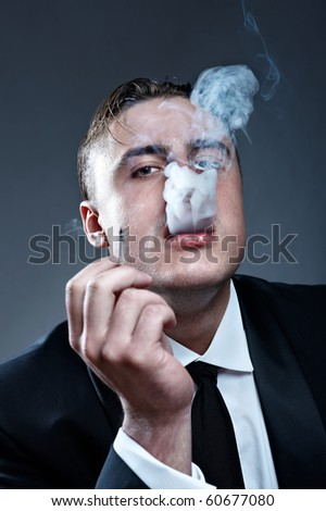 Portrait of handsome young smoker - stock photo