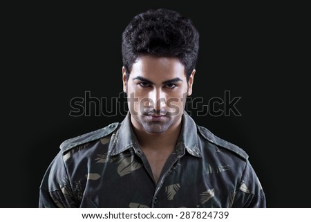 Portrait of handsome young soldier - stock photo