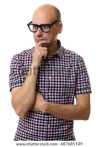 Portrait of handsome young thoughtful bald man isolated over white background