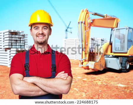 portrait of handyman at construction site - stock photo