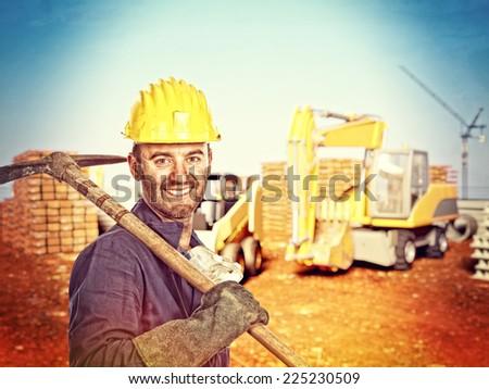 portrait of handyman at construction site - stock photo