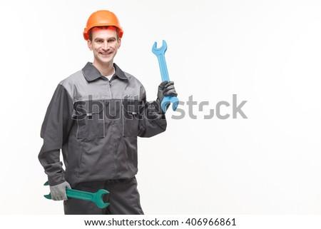 portrait of handyman holding wrench isolated on white background - stock photo