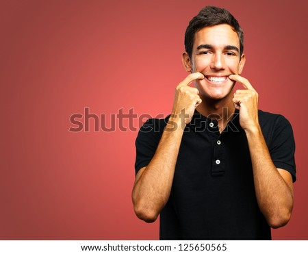 Portrait Of Happy A Boy against a red background - stock photo