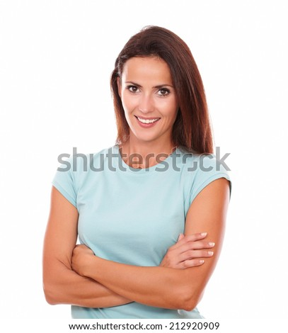 Portrait of happy adult woman on blue shirt with crossed arms smiling at you on isolated white background - stock photo
