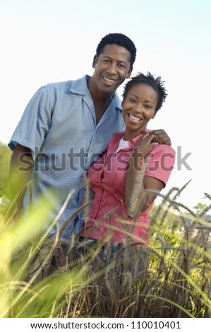 Portrait of happy African American couple smiling - stock photo
