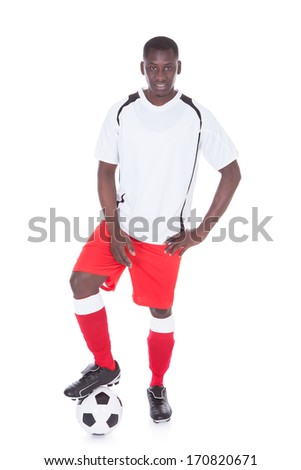 Portrait Of Happy African Soccer Player With Ball Over White Background