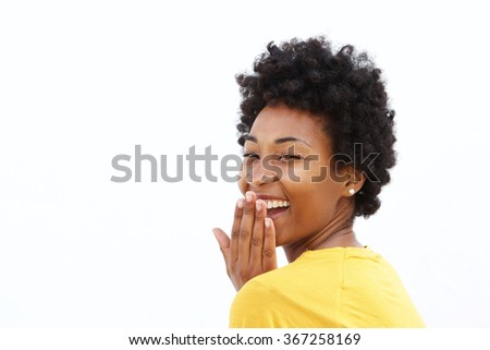 Portrait of happy african woman covering her mouth and laughing against white background  - stock photo