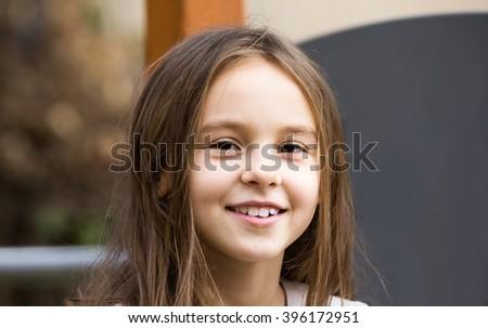 Portrait of happy american girl in autumn - stock photo