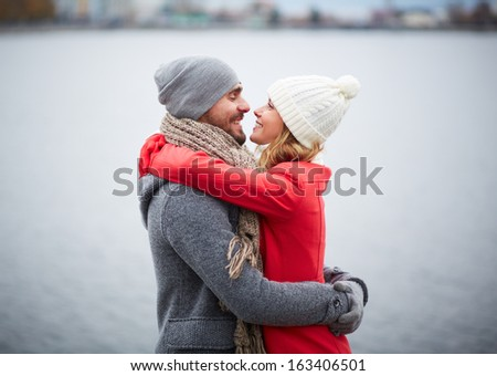 Portrait of happy and his girlfriend in embrace - stock photo